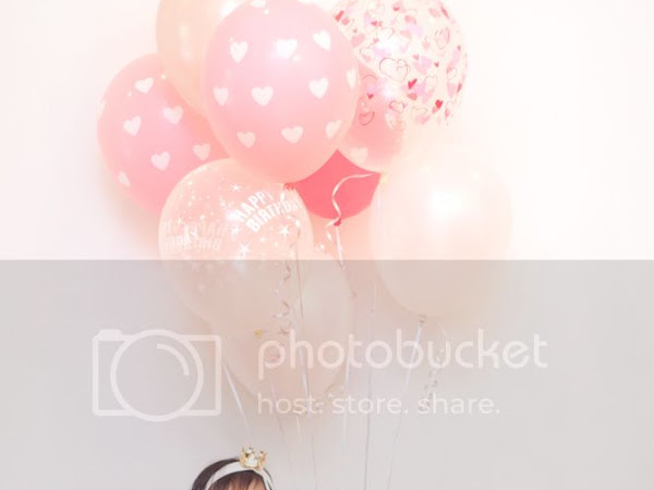 A girl and her balloons...