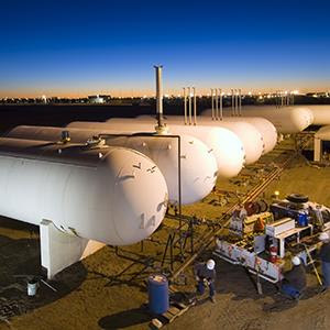 Natural gas tanks at a site in North Dakota (© Rich LaSalle/The Image Bank/Getty Images)