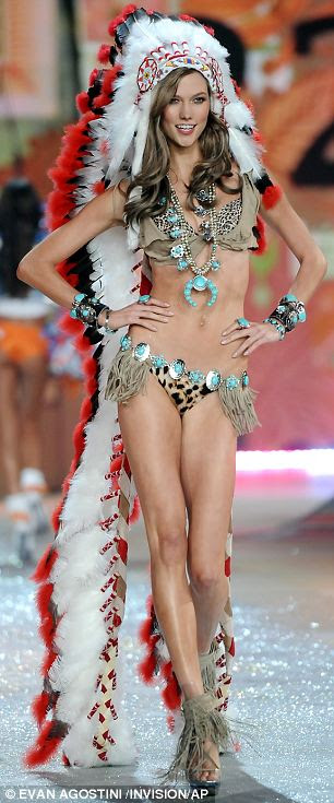 Karlie Kloss wearing an Indian headdress during the 2012 Victoria's Secret Fashion Show in New York