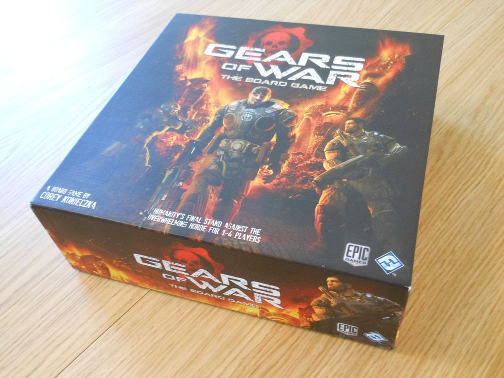 The box for Gears of War: The Board Game, featuring Fenix striding into battle against alien enemies.