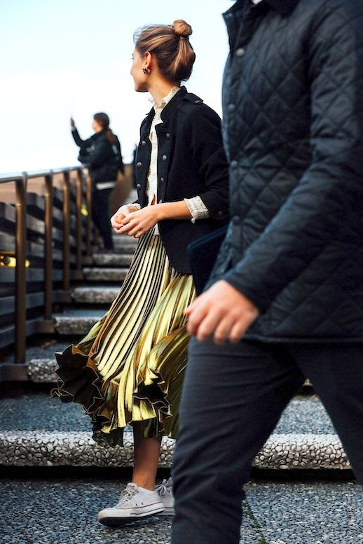 Le Fashion Blog Street Style Varsity Jacket Metallic Gold Pleated Skirt Converse Sneakers Via Vogue