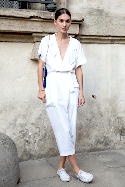 Le Fashion Blog Street Style Bun White Belted Jumpsuit Blue Shoulder Bag Sneakers Via Grazia Russia