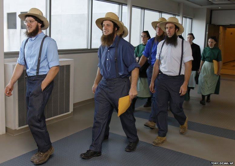 Members of the Amish community leave the US. Federal Courthouse in Cleveland