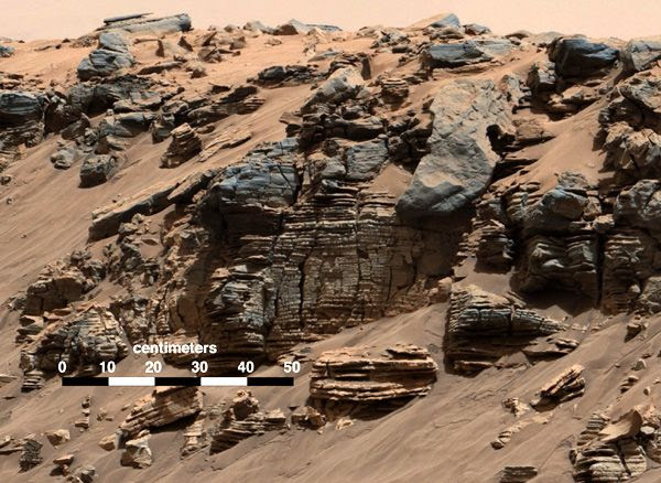 An image of several layered rocks that was taken by NASA's Curiosity Mars rover on August 7, 2014, showing evidence of a sedimentary deposit that possibly came from flowing water entering an ancient lake.