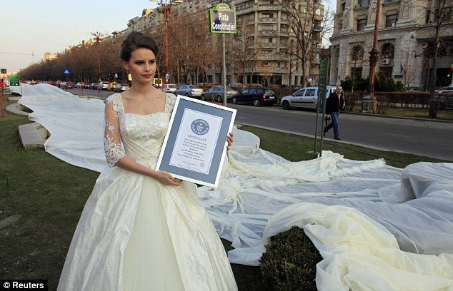 Emma poses with a certificate that the train is the longest in the world