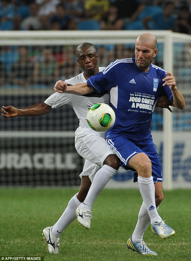 Still got it: Zinedine Zidane tries to shield the ball from Brazilian player Amaral