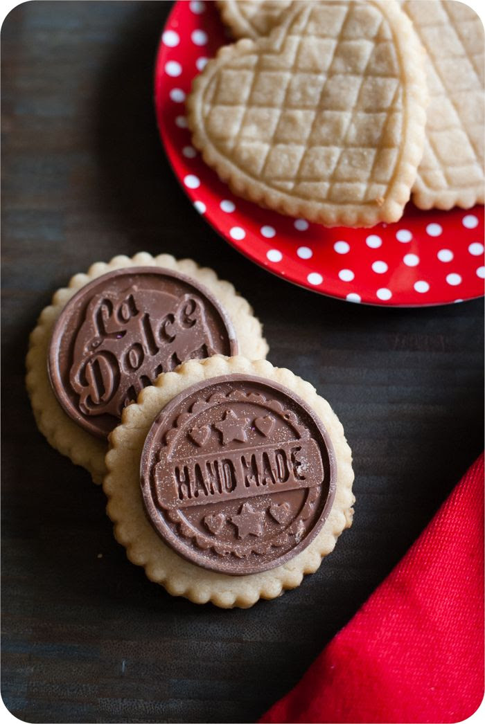 salted almond shortbread cookies with milk chocolate toppers