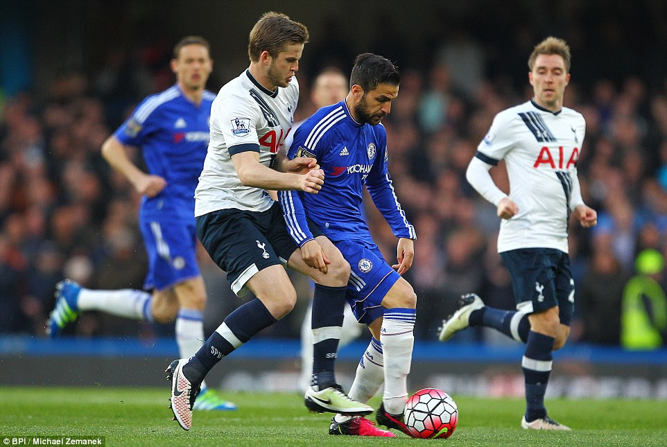 Spurs midfielder Eric Dier, who recovered from concussion to take his place in the starling line-up, tracks the run of Fabregas