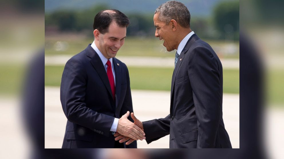 PHOTO: President Barack Obama is greeted by Wisconsin Gov. Scott Walker as he arrives on Air Force One at La Crosse Regional Airport, July 2, 2015, in La Crosse, Wis.
