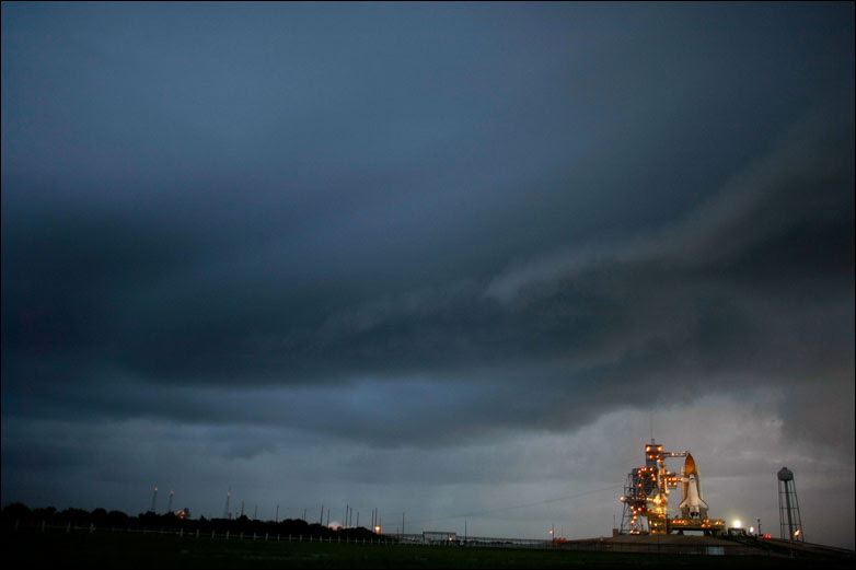 The Space Shuttle Discovery stands on launch pad 39-A