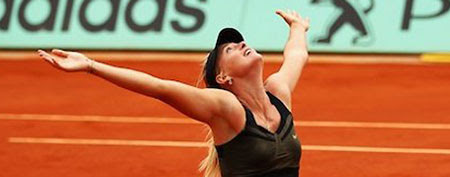 Maria Sharapova celebrates her French Open win on Saturday. (Getty Images)