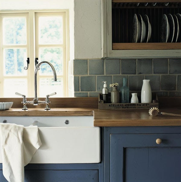 What a great undermounted, farm style sink when paired with the countertops and cabinet styles.