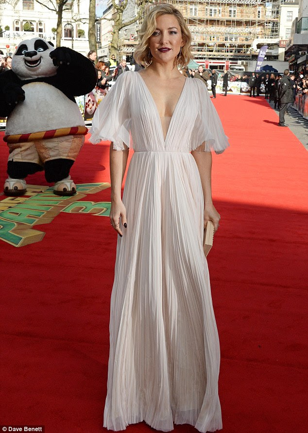 Flaunting fashion: Kate - who voices the character of Mei Mei in the third big screen installment of the franchise - slipped her enviable slim curves into a floating pink gown for the daytime premiere