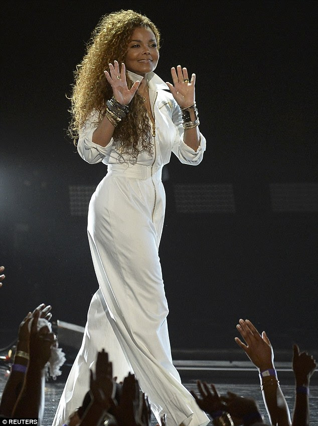 White hot: The 49-year-old legend graced the stage donning a billowy white jumpsuit