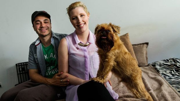 Breast cancer survivor Joanne Maillet with her husband Marcus and dog Elvis at home in South Yarra.
