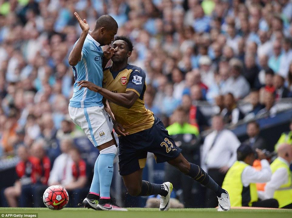 Manchester City midfielder Fernandinho (left) accidentally fouls Arsenal forward Danny Welbeck during the opening exchanges of the tie