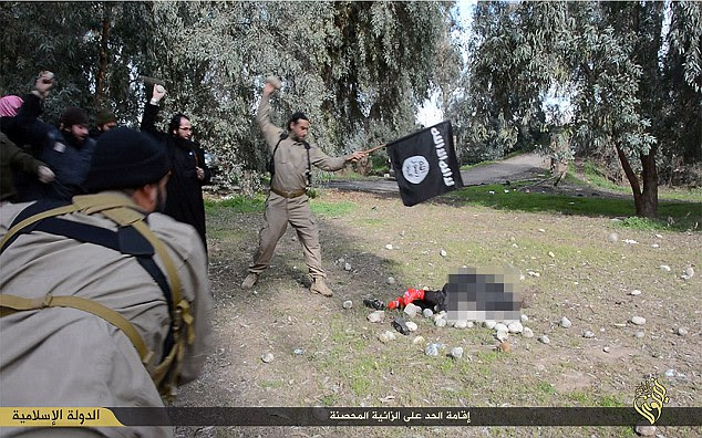 The image released by ISIS shows a woman accused of adultery being brutally stoned to death