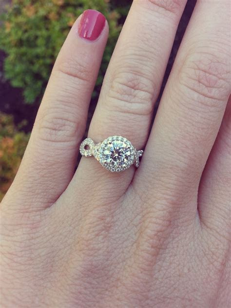 Custom round brilliant halo engagement ring with infinity