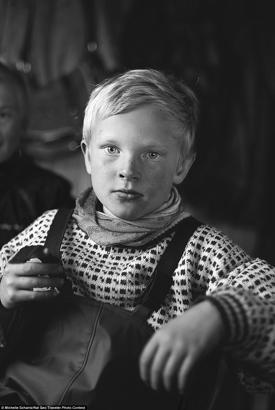 Little helper: Mikael Ande, a child of Sami reindeer herders, takes a break indoors after a long, cold day of rounding up the animals for vaccinations and slaughter