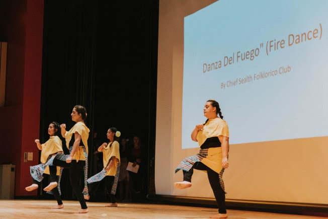 Four members of the Chief Sealth Folklorico Club performing the Dancza Del Fuego (Fire Dance).