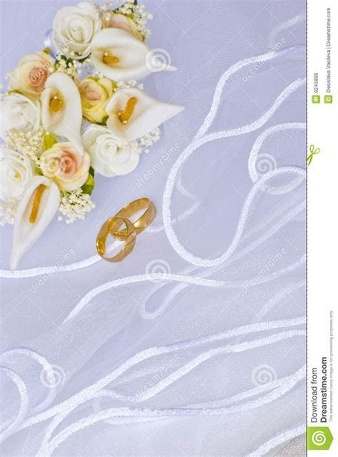Wedding Rings And Flowers Over Veil Royalty Free Stock