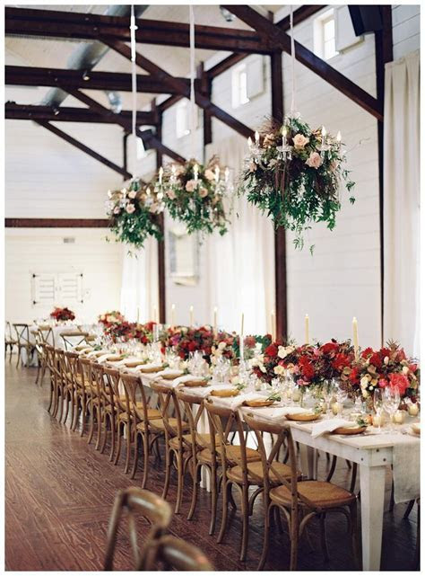 Fall wedding reception. Uncovered white wooden farm table