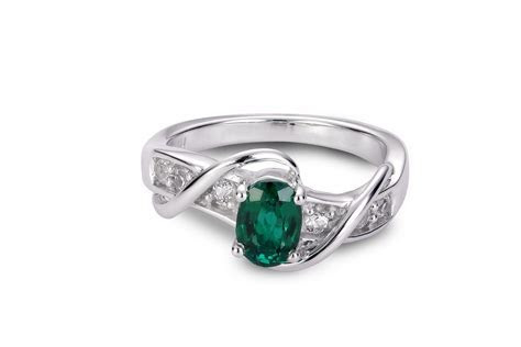 OVAL CREATED EMERALD AND SAPPHIRE RING   Charm Diamond Centres