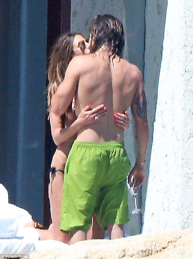 Romantic: Her long hair fell down across her chest as she and her new boyfriend got intimate while on a lounge chair