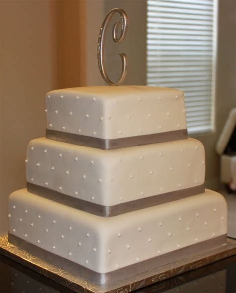 3 tier wedding cake. Simple and beautiful.   A slice of