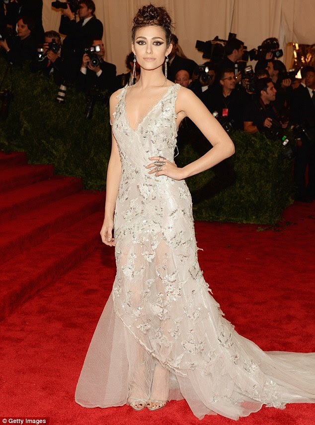Fairytale princess: Emmy Rossum looked beautiful in a flowing off-white gown with bead embellishment