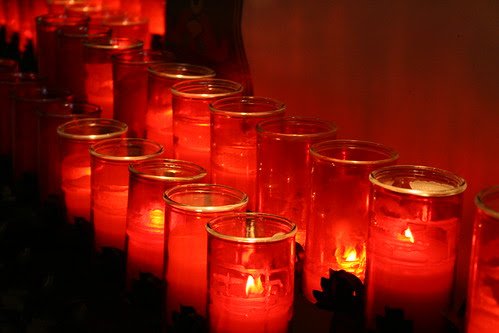 Red candles at Mission Capistrano