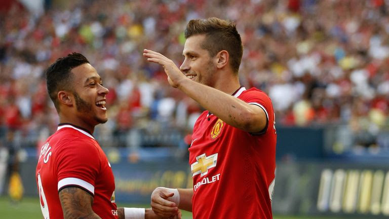 Morgan Schneiderlin celebrates scoring on his Manchester United debut