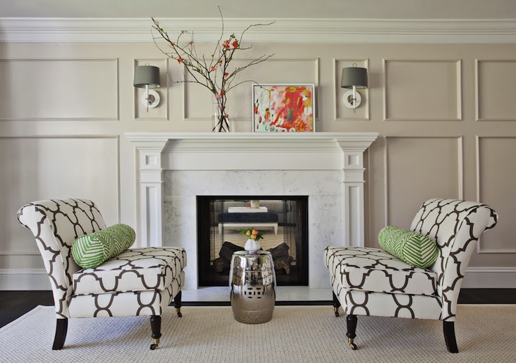 Suzie: Fiorella Design - Formal living room with decorative wall moldings, silver garden stool, ...