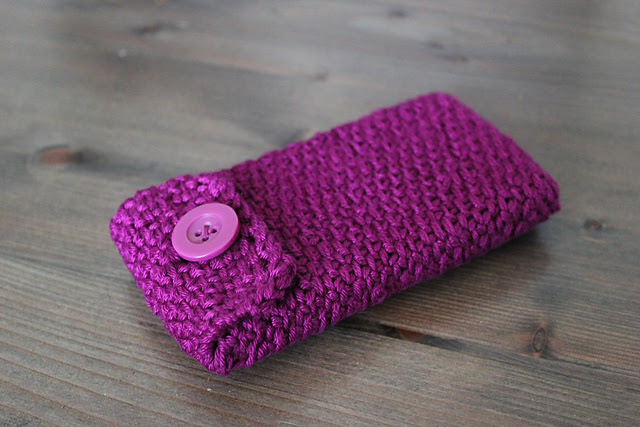 http://www.ravelry.com/projects/misshendrie/phone-cover-2