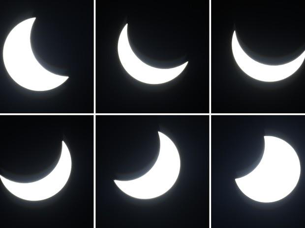 Combinação de imagens mostra a Lua atravessando a frente do Sol durante o eclipse desta sexta-feira (20). As imagens foram feitas em Berlim, na Alemanha (Foto: Michael Sohn/AP)