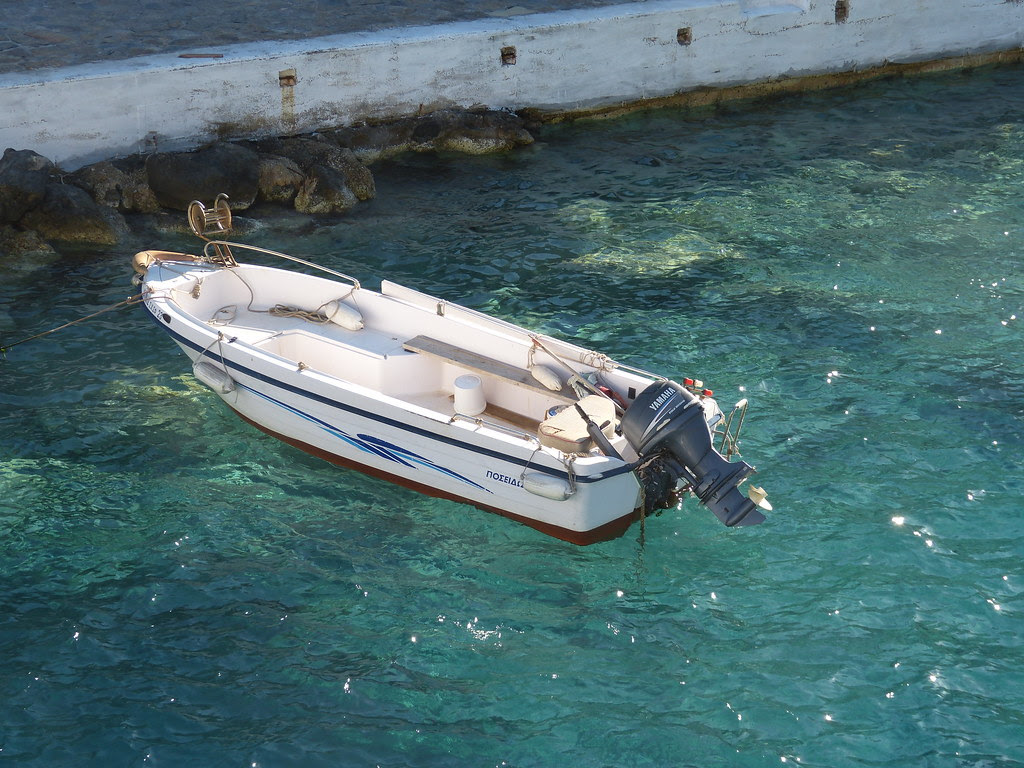 This boat looks almost suspended on the water, Loutro, Crete