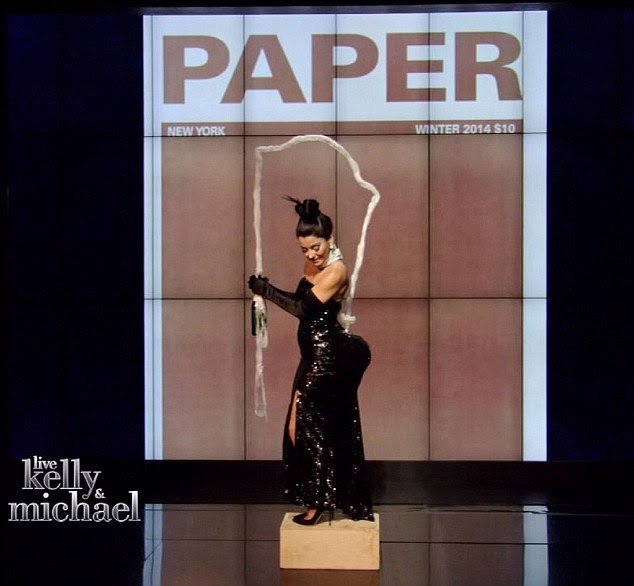 Cover girl: Kelly's costume featured a shimmery strapless dress and plenty of derriere padding