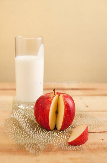 an apple & a glass of fresh laban