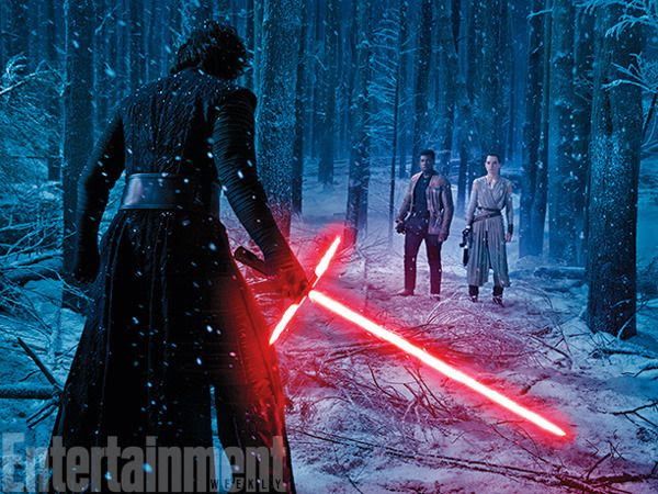 Rey (Daisy Ridley) and Finn (John Boyega) confront Kylo Ren (Adam Driver) in STAR WARS: THE FORCE AWAKENS.