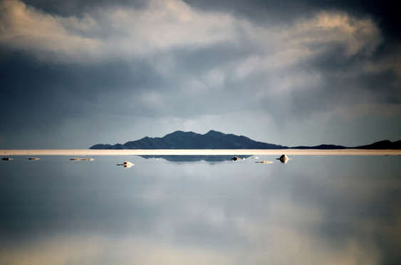 Solitary island at salt flat, Salar De Uyuni, Potosi Department, Bolivia