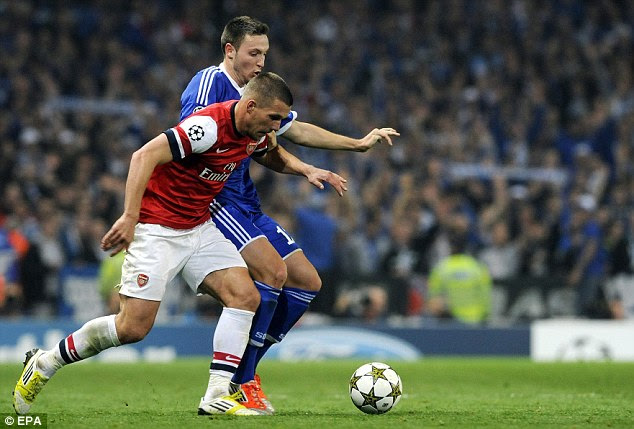 Race for the ball: Lukas Podolski and Marco Hoger chase the ball