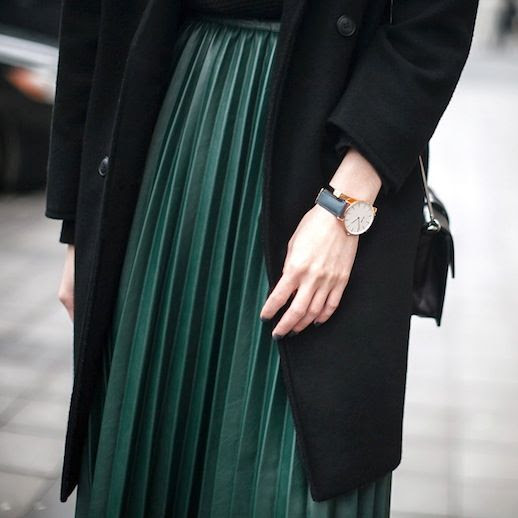 Le Fashion Blog Blogger Style Black Longline Coat Round Watch Green Pleated Skirt Via Fashion Agency