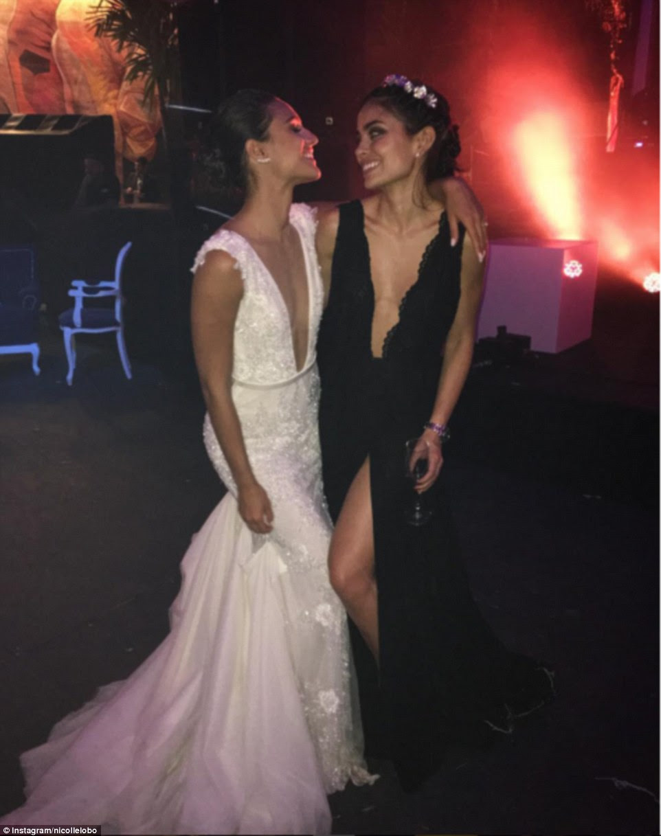Skimpy black dresses were the order of the day with even bridesmaid, Brazilian model Nicolle Lobo, wearing a gown that was slashed at the front with a thigh high split