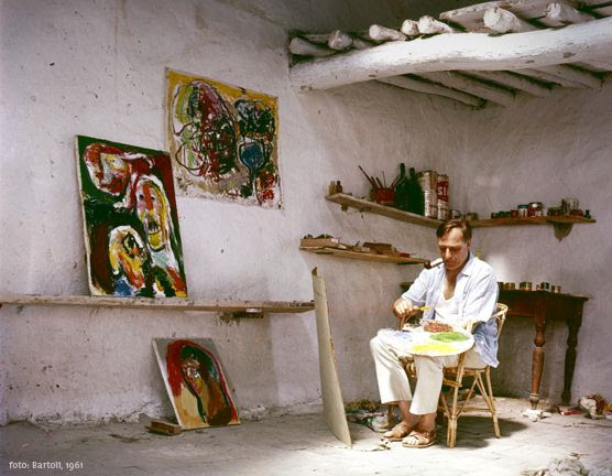 Asger Jorn (1914- 1973), Danish artist working in his house in Albissola, 1961.