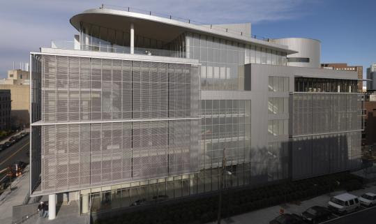 MIT's Media Lab extension is sheathed in glass and metal screens that allow about half the sunlight into the interior, where twin atriums feel laced together by imaginary diagonals.