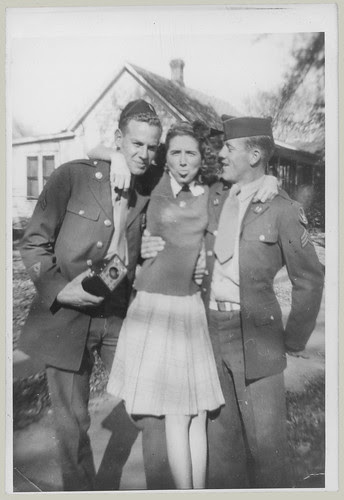Girl and two uniforms