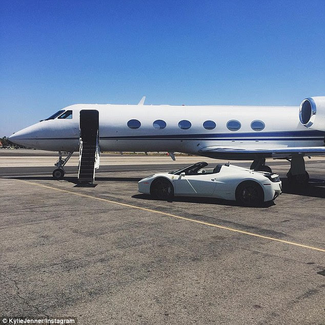 Travel in style: Kylie Jenner kept the celebrations going driving her Ferrari to her private jet flight out of Los Angeles, California, on Monday