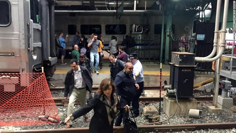 Passengers rush to safety after a train plowed into a platform at Hoboken station.