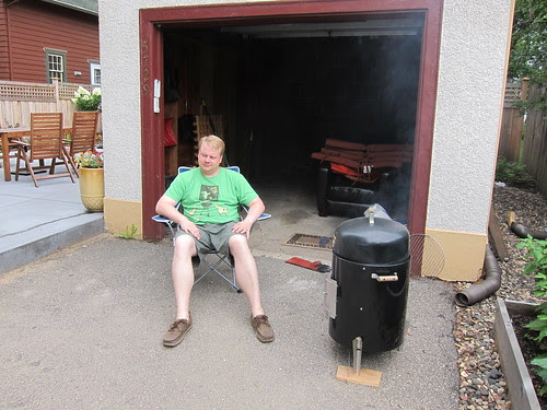 Tending the smoker is hard work