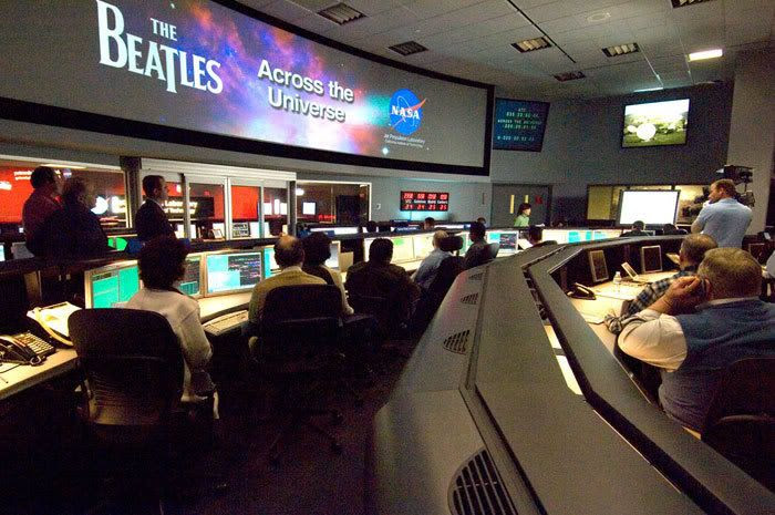 On February 4, 2008, folks in Mission Control at NASA's Jet Propulsion Laboratory in Pasadena, Calif. gaze at monitors indicating that a transmission of the Beatles tune 'Across the Universe' was successfully beamed up into space.